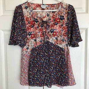 Anthropologie has Paris floral blouse top